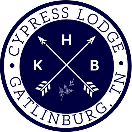 Two crossed arrows with KHB and cypress leaf in the inside circle. Outside circle reads Cypress Lodge, Gatlinburg, TN