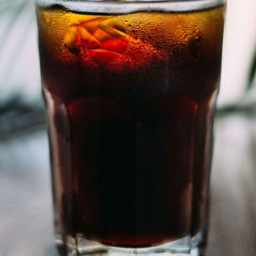 Glass with ice, tennessee whiskey alcohol, and coke