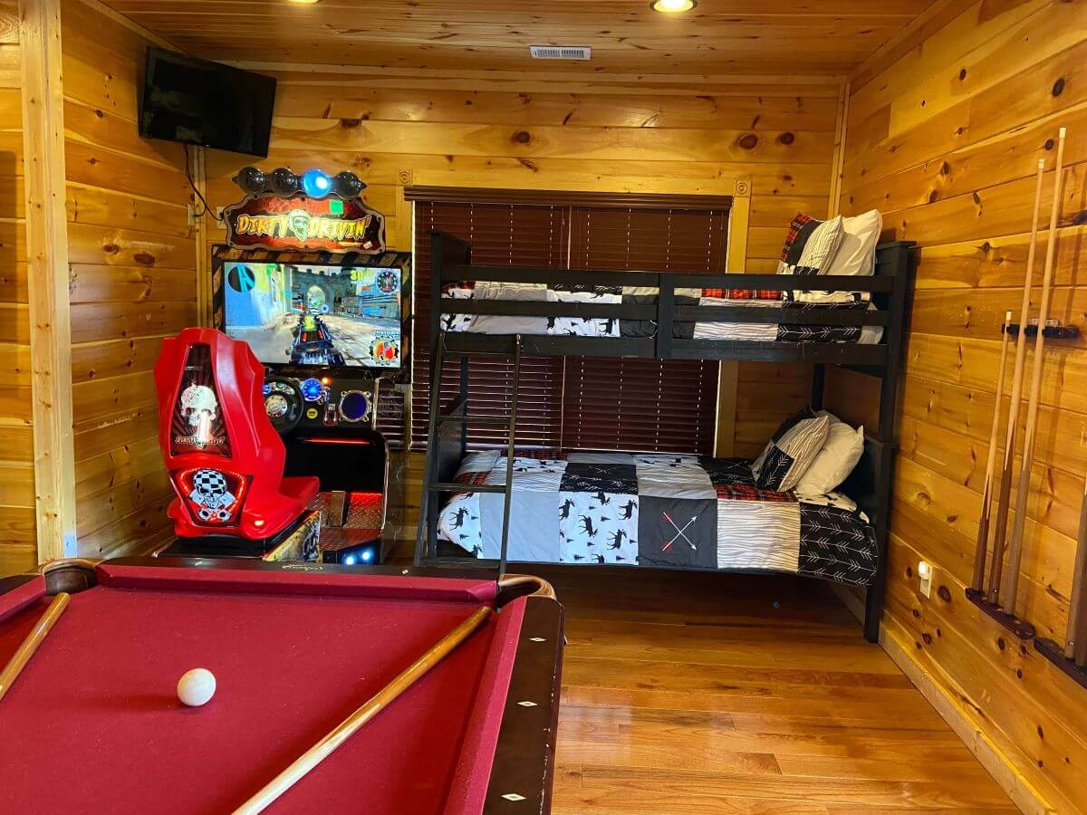 Cypress Lodge Bunk Bed in the arcade room with dirty driving and pool table