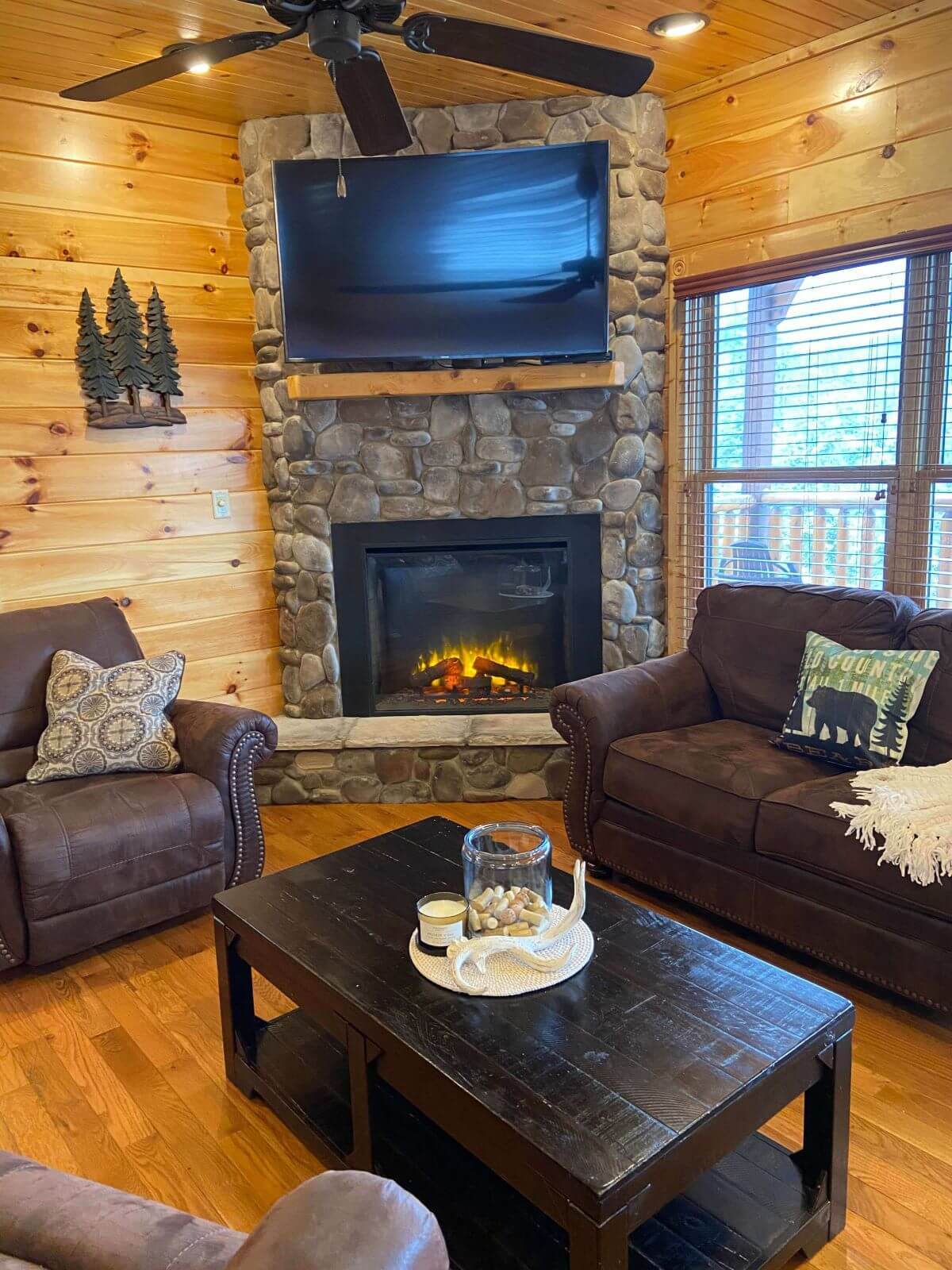 Cypress Lodge living room with stone fireplace