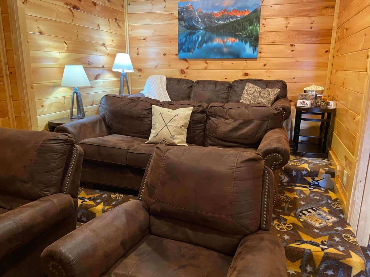 Cypress Lodge private movie theatre room with two couches and two chairs